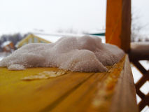 Snow on rafters in pergola. Cold snow on the anteroom of the hallway royalty free stock photo