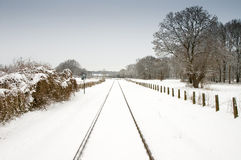 Snow and railway with pale blue sky. Snow landscape and railway track with pale blue sky Stock Images