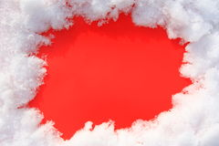 Snow on a red background. Framework of snow. Form for inscription Stock Photography
