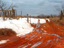 Snow and Red Clay Royalty Free Stock Image