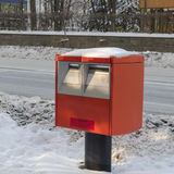 Snow and Red mailbox of Japan Post Service in Japan. Royalty Free Stock Images