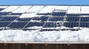 Snow reducing output of  photovoltaic panels Stock Images