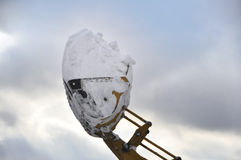 Snow Removal. High lift truck carrying snow for removal after winter storm Stock Photo