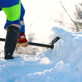 Snow Removal. Working cleans the road from snow Stock Photography
