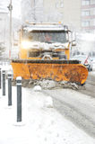 Snow removal. Snow plow truck spreading salt Stock Photo