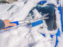 Snow removal from car body Royalty Free Stock Photo