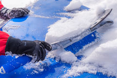 Snow removal from car body Stock Photography