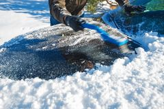 Snow Removal From Car Royalty Free Stock Images