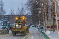 Snow removal in the city stock photos