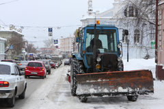 Snow-removal equipment. Russia. Tomsk. Snow-removal equipment cleans of the snow on the street Royalty Free Stock Photos
