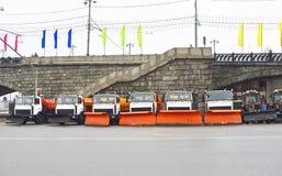 Snow removal equipment near the Stone Bridge Royalty Free Stock Photos