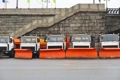 Snow removal equipment near Stone Bridge Royalty Free Stock Photo
