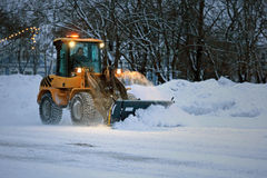 Snow Removal in the Evening stock photography