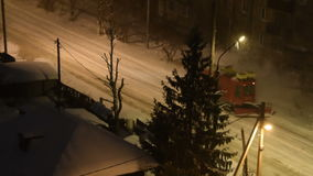 Snow removal machine cleaning tram rails at night stock video footage
