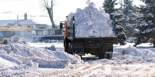 Snow-removal machine cleans the street of snow.  royalty free stock photography