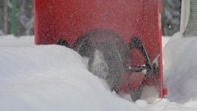 Closeup Of The Rotating Blade Of A Snowplow Removes Snow Drifts After A Snowfall. Snow removal machine clears snow after a snowfall on a winter day. Close up of stock video