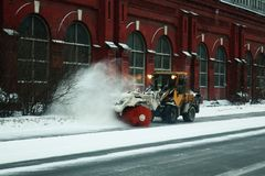 Snow removal machine from the sidewalk. Snow removal machine on the street after heavy snowfall stock photos