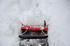 Free Snow Removal.Red Snow Shovel Royalty Free Stock Photos - 197941418