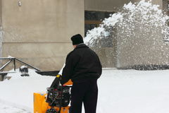 Snow removal on the sidewalk Royalty Free Stock Photography