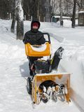 Snow removal with a snowblower Royalty Free Stock Images