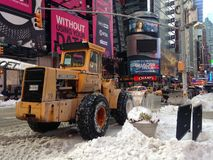 Snow Removal Tractor on Times Square in Snow in Winter. Stock Photo