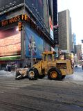 Snow Removal Tractor on Times Square in Snow in Winter. Royalty Free Stock Image