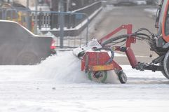 Snow removal using heavy machinery. Stock Photography