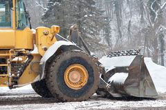 Snow removal vehicle. Removing snow Stock Images