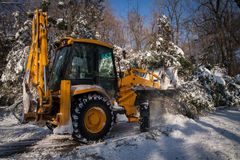 Snow removal vehicle cleaning after snowstorm Royalty Free Stock Photos