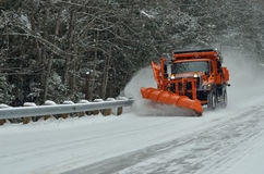 Snow removal vehicle removing snow after blizzard. In New Hampshire, USA Stock Photography