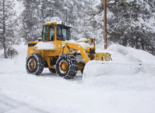 Snow removal vehicle removing snow Stock Image