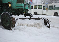 Snow removal vehicle removing snow Stock Images
