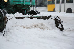 Snow removal vehicle removing snow Royalty Free Stock Images