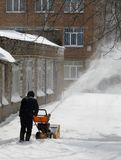 Snow removal with a snowblower Stock Images