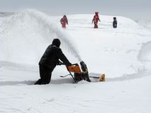 Snow removal with a snowblower Royalty Free Stock Photos