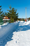 Snow-removed road in countryside Stock Photography