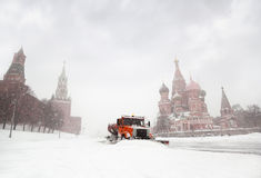 Snow-remover truck clean road near Red Square Royalty Free Stock Photo