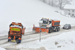 Snow remover trucks at work Stock Photo