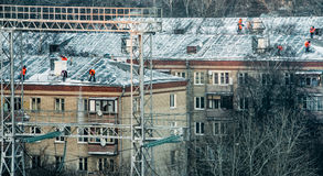 Snow-removers on roofs Stock Image