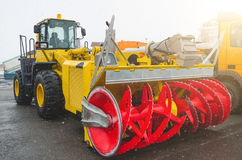 Snow-removing machine, parking in the airport in winter. Royalty Free Stock Photography