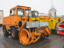 Snow-removing machine, parking in the airport in winter. Stock Image
