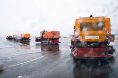 Snow removing machine, on roads cleaning snow. Snow removing machine, on roads cleaning snow Stock Photography