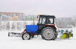 Snow removing tractor Stock Photos