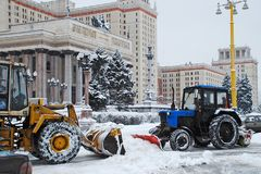 Snow removing tractors at Moscow State University Stock Photography