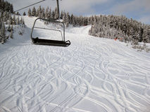 Snow resort. Ski lift an fresh skied snow in a sunny day Royalty Free Stock Photography