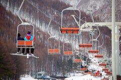 Snow Resort - gondola lifter. A couple takes ride of gondola lifter at a snow resort in Fukushima, Japan Stock Image