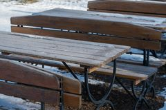 Snow on the restaurant`s  table. Winter concept Royalty Free Stock Photos