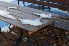 Snow on the restaurant`s  table. Winter concept Royalty Free Stock Photo