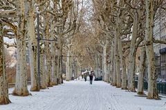Snow on Rhone river banks pedestrian walk way. LYON, FRANCE, March 1, 2018 : Pedestrian walkways on Rhone river banks, as a cold spell rages in all Europe and Stock Images