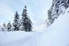 Snow road. Snow covered road on mountains in winter Stock Images